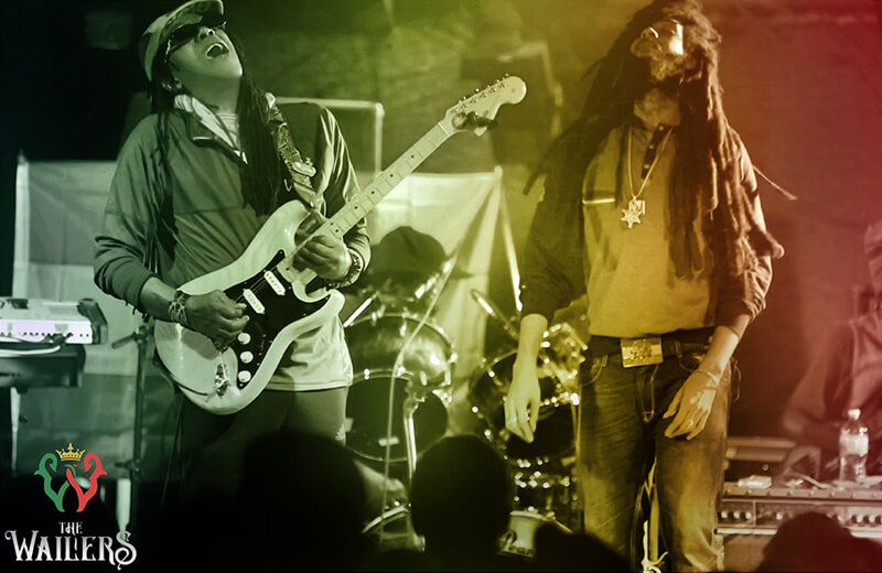 Julian Junior Marvin and Josh David Barrett on stage playing with The Wailers