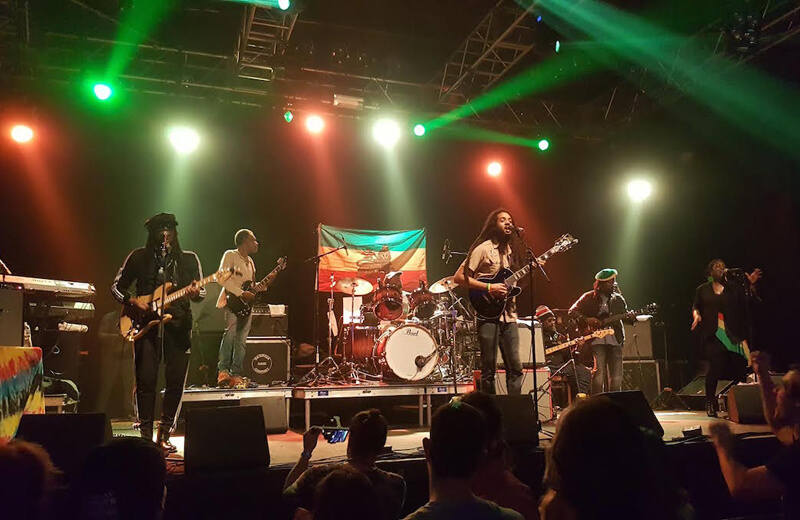 The Wailers playing music on stage